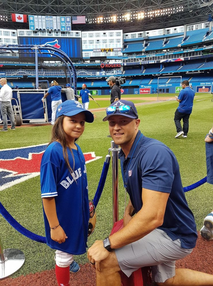 PHOTO: Ashlynn Theiren with her baseball coach Andrew Haines at a Toronto Blue Jays game.