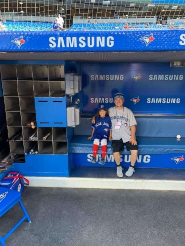 PHOTO: Ashlynn and Dan Theiren in the dugout at a Toronto Blue Jays game.