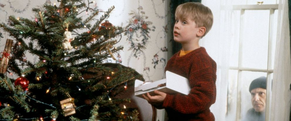 "PHOTO: Joe Pesci, right, as Harry Lime, peers through a window at Macaulay Culkin, as Kevin McCallister, as he decorates a Christmas tree in scene from the 1990 film, ""Home Alone."""