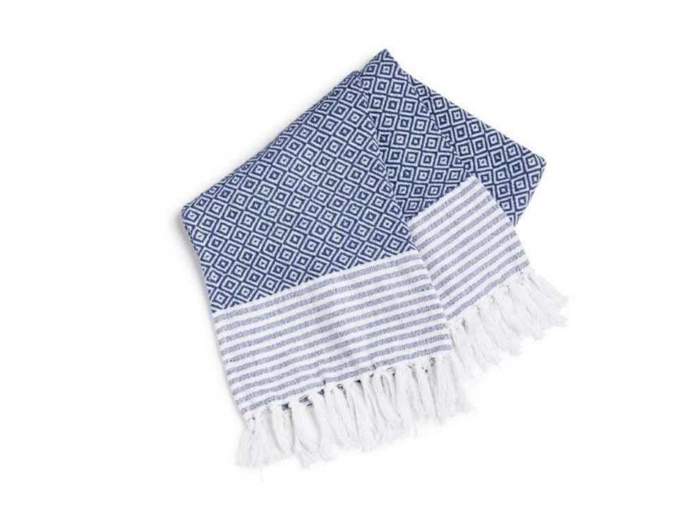 PHOTO: A simple and stylish blue and white throw blanket from HomeGoods.
