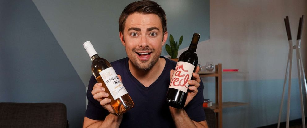 """PHOTO: Jonathan Bennett with the two Nocking Point wines inspired by """"Mean Girls."""""""