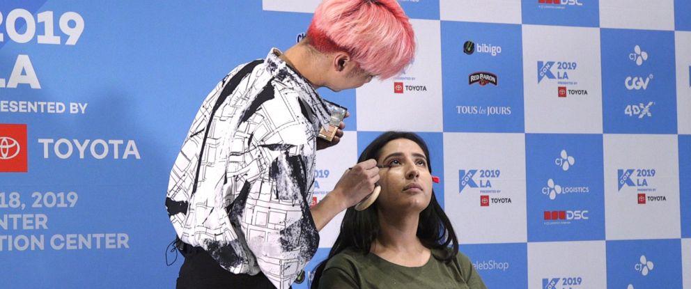 PHOTO: Youtube makeup artist, Edward Avila gives intern, Karolina Rivas a K-Beauty makeover.
