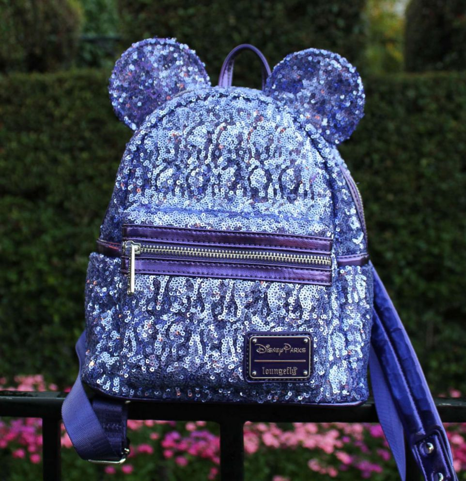 PHOTO: The Loungefly Potion Purple Mini Backpack features a glamorous sequined design and Minnie ears with her signature bow.