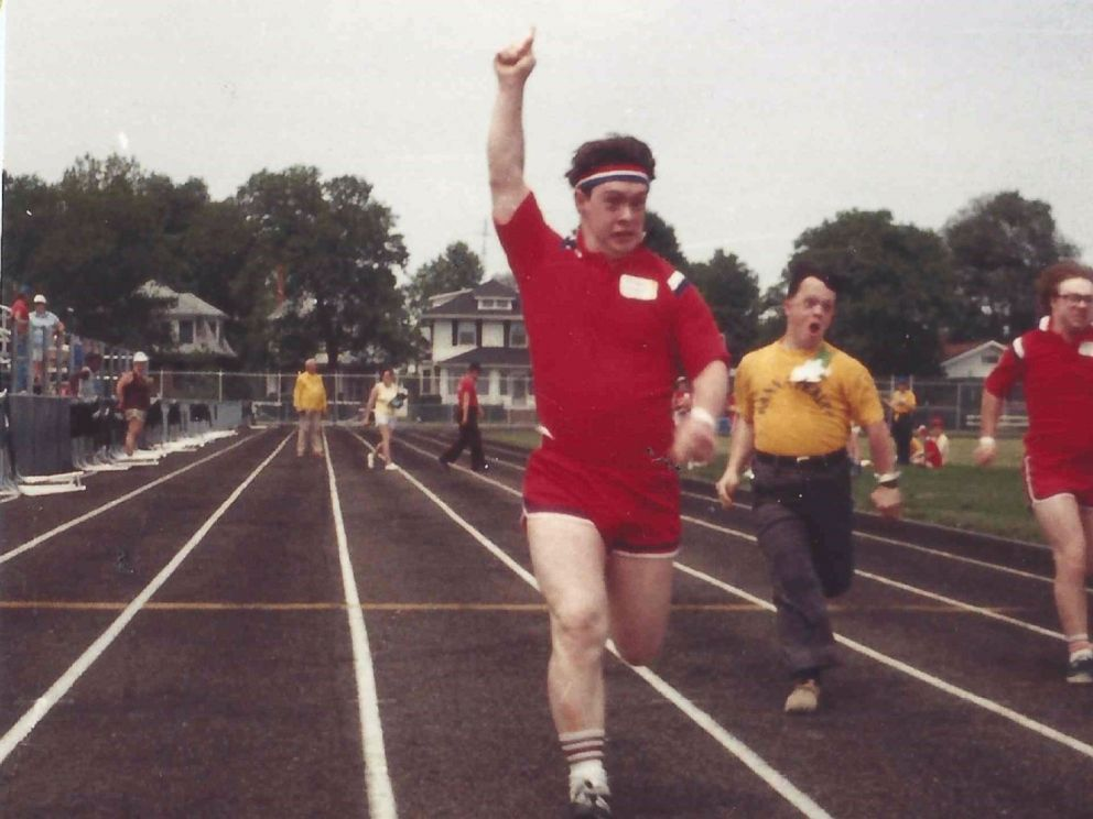 PHOTO: Michael Nawrocki winning the race at the Special Olympics.