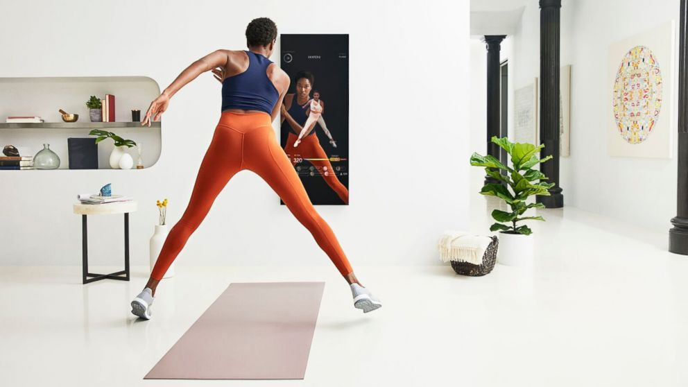 A user demonstrates a workout with Mirror.