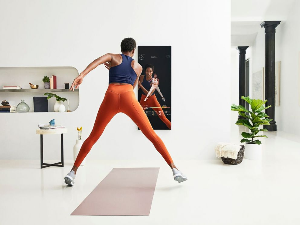PHOTO: A user demonstrates a workout with Mirror.