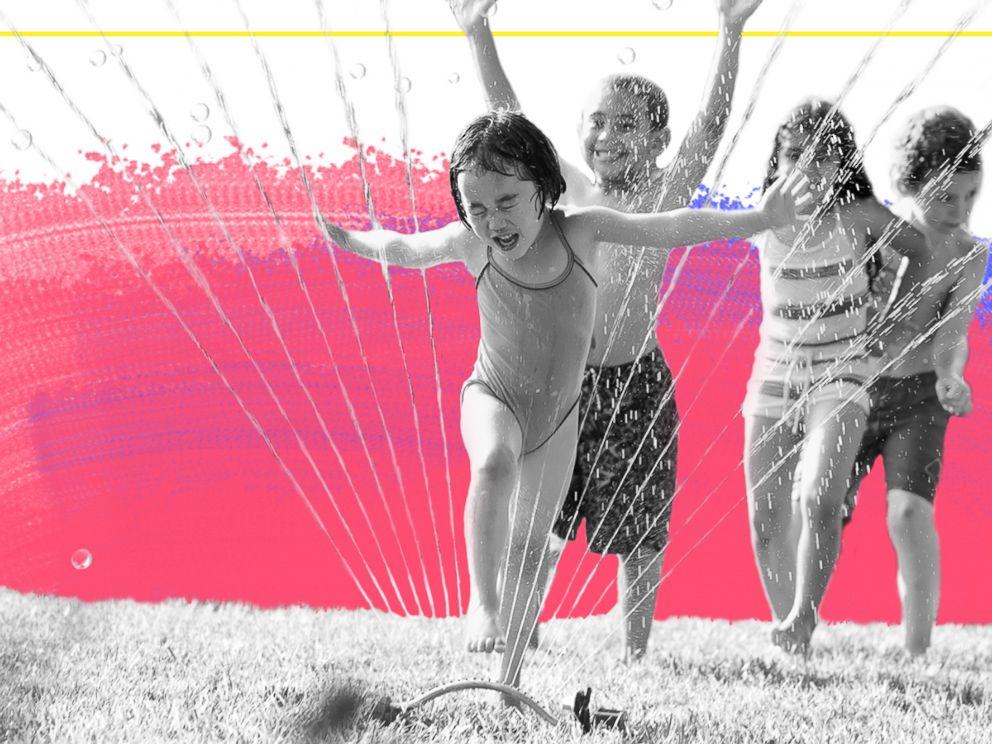 PHOTO: Children run through a water sprinkler in this undated stock photo.