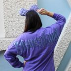 """The Potion Purple Spirit Jersey features long sleeves and a shimmery resort logo with a """"D"""" icon on the front while the back displays Disneyland Resort in its signature font."""