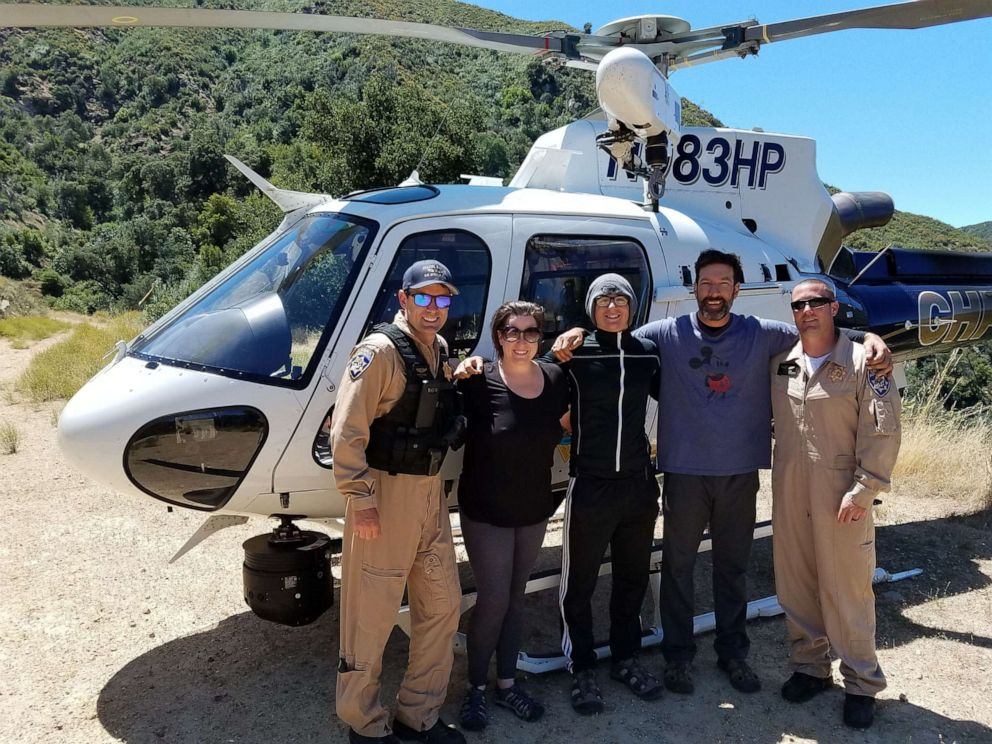 PHOTO: Pilot Joe Kingman with Curtis Whitson, Hunter Whitson and Krystal Ramirez after they were successfully rescued.