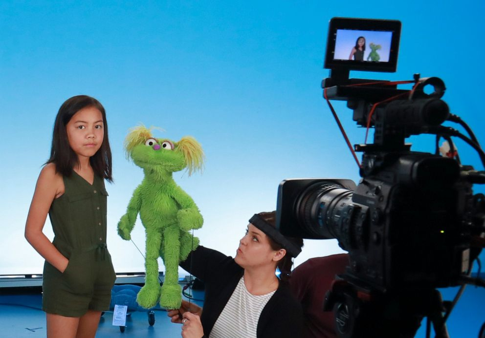 "PHOTO: Salia Woodbury, 10, left, from Irvine, Calif., on the set with ""Sesame Street"" muppet Karli and puppeteer Haley Jenkins during a taping about parental addiction in New York."