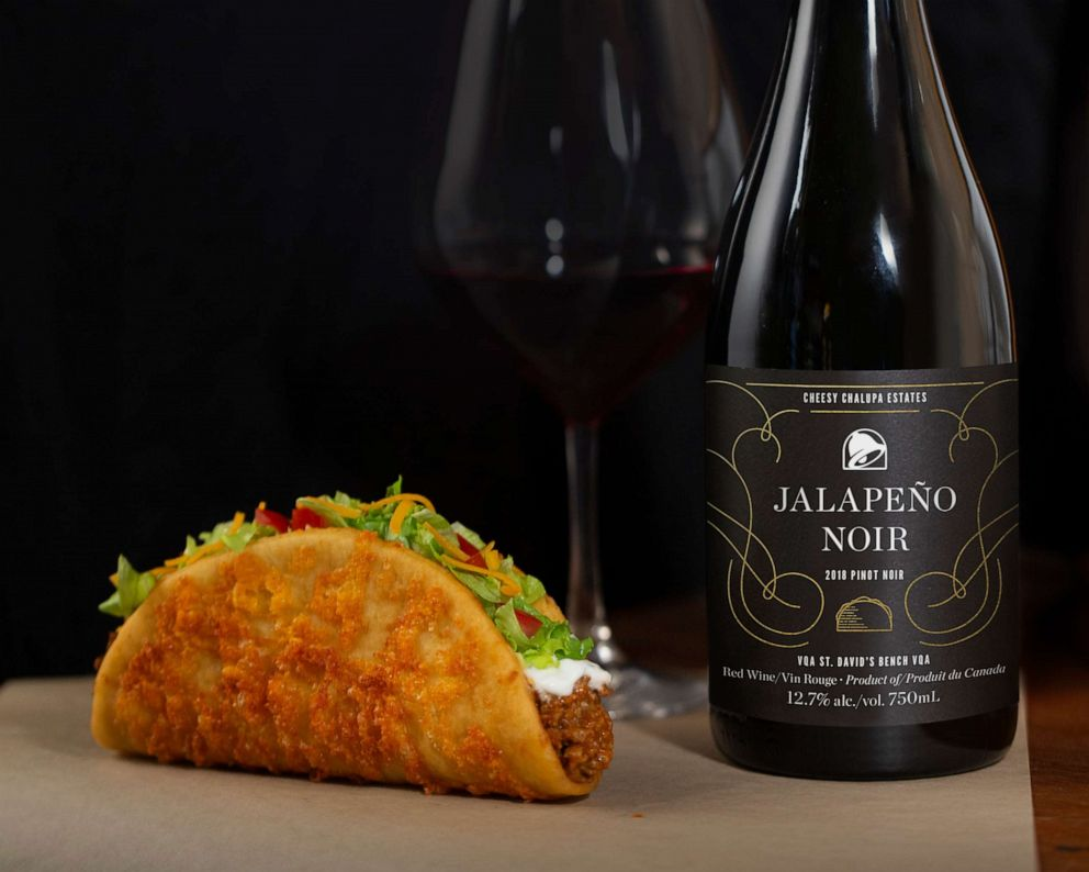 PHOTO: An aged-cheddar chalupa and Jalapeno Noir wine from Taco Bell in Canada.