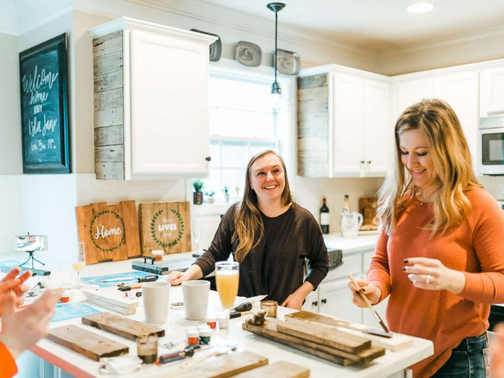 PHOTO: Ashley McAlpin, left, joins a friend in working on a McAlpin Creative DIY kit.