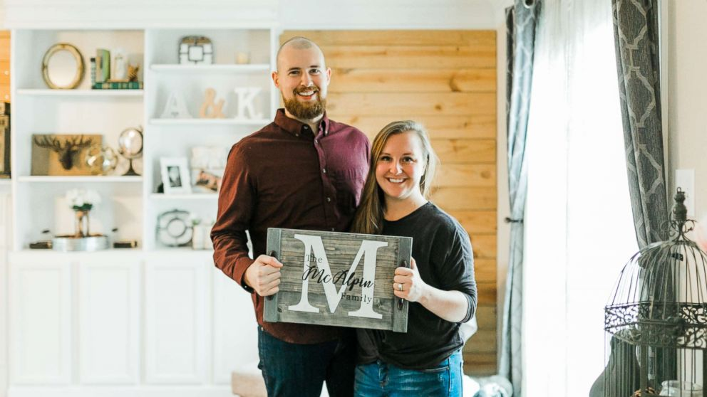 Kevin and Ashley McAlpin pose with a product from their company, McAlpin Creative.