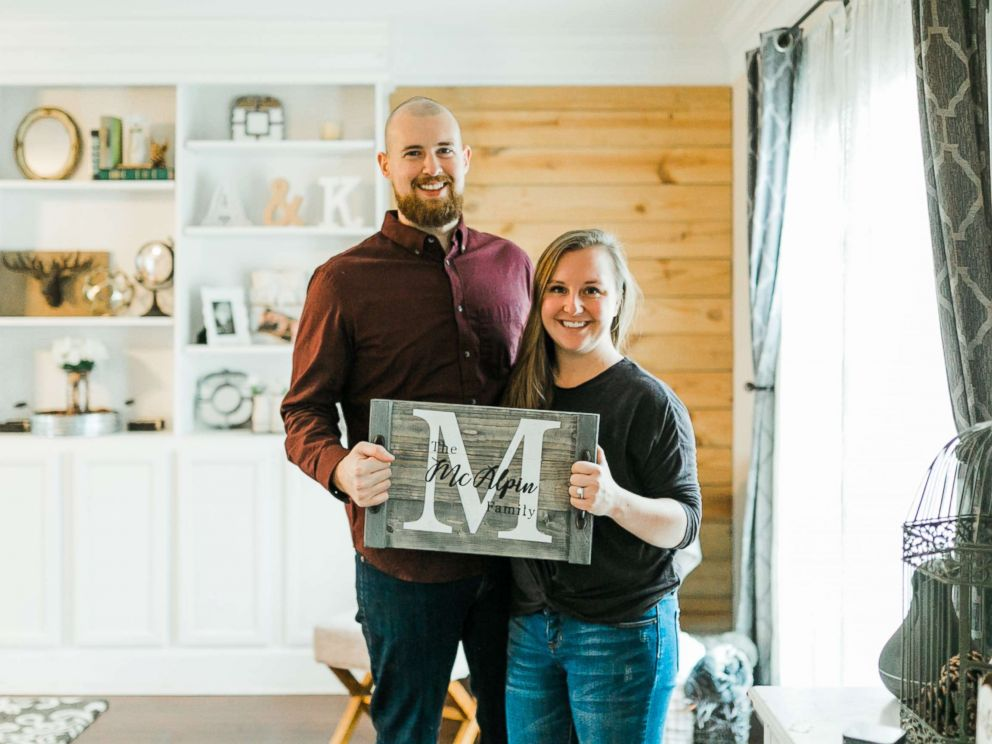 PHOTO: Kevin and Ashley McAlpin pose with a product from their company, McAlpin Creative.