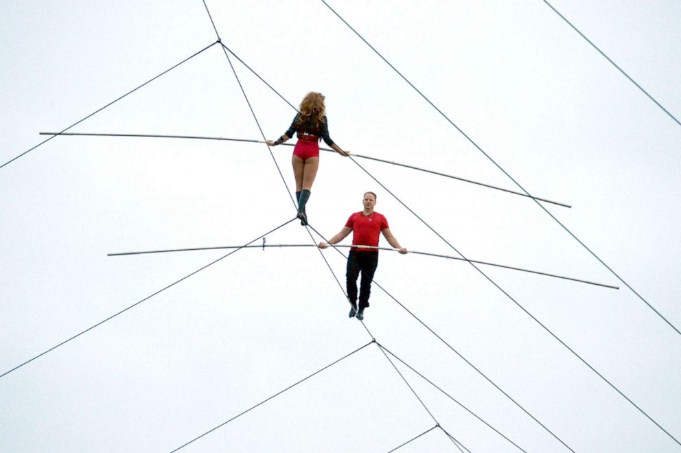PHOTO:Nik Wallenda, right, walks the tightrope above Charlotte Motor Speedway, October 12, 2013, with his sister, Lijana, 140 feet above pit road during the pre-race show at the Bank of America 500 NASCAR Sprint Cup race in Charlotte, N.C.
