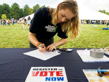 PHOTO: A young woman registers to vote.