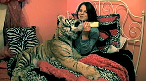 PHOTO: Felicia Fresco, 17, and pet tiger are seen here in Tampa, Fl. in this file photo. Fresco is know to sleep with her tiger. Her family runs an organization called Tiger Encounter.