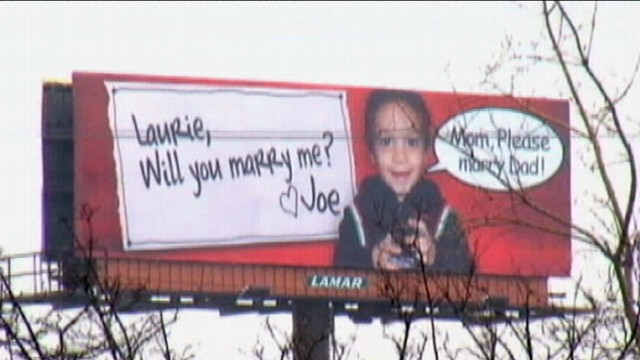 VIDEO: New York man wins girlfriends heart with a billboard featuring her son.