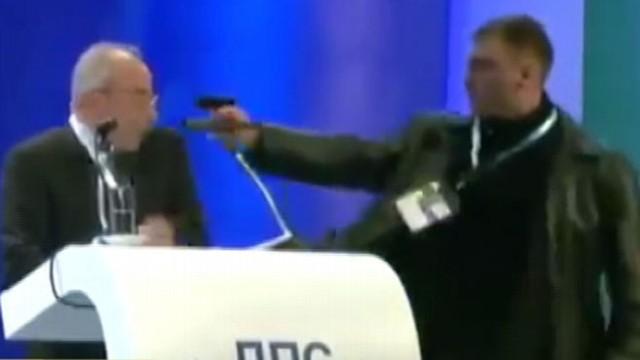 VIDEO: Assassin storms stage during political speech, gun fails to fire.