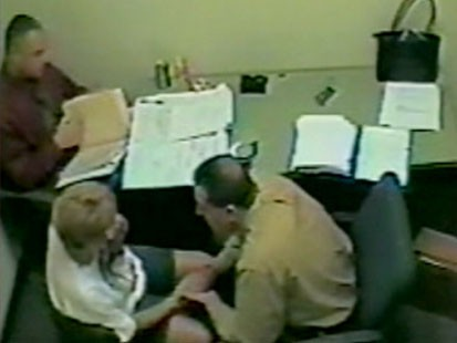 A picture of Casey Anthonys mother being interrogated by police.