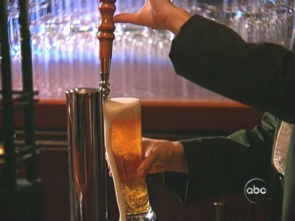 A picture of some one pouring a beer.