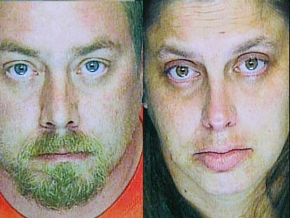 A picture of the accused Girl Scout leader and her husband.
