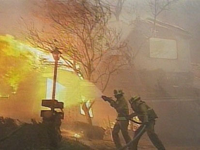 A picture of fire fighers fighting fire.
