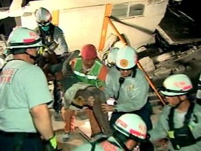 VIDEO: Search and rescue teams frantically work to pull survivors from rubble.