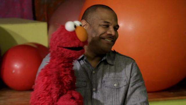 Man Celebrates 26 Years Voicing Elmo