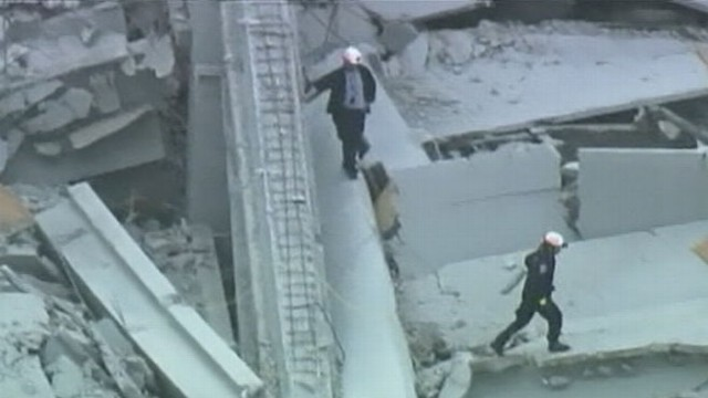 VIDEO: A man was pulled from the rubble hours after a deadly parking garage collapse.