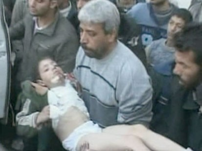 VIDEO: A man carrying an injured boy.