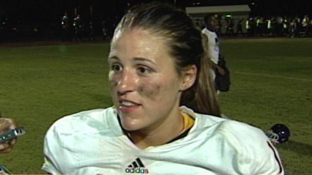 VIDEO: Female breaks gender barrier when she leads her high school football team.