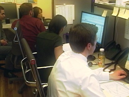 VIDEO: After months of cascading job losses, companies are laying off fewer people.