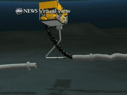 VIDEO: Tube inserted into broken well pipe is siphoning some of the escaping oil.