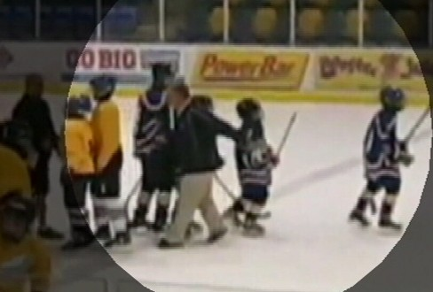VIDEO: A hockey coach was caught on tape tripping an opposing team?s player, breaking his wrist.