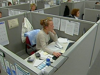 VIDEO: A group of women working in an office.