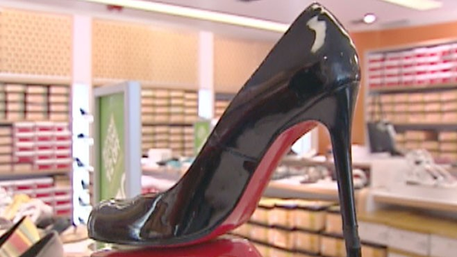 0777ee1042eb VIDEO  At stake is the trademark red sole of designer shoes for woman.