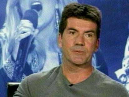 VIDEO: Simon Cowell focuses critical eye on himself as he nears his 50th birthday.