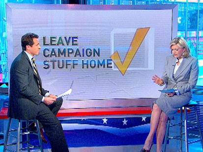 A picture of Chris Cuomo and Diane Sawyer answering voting questions.