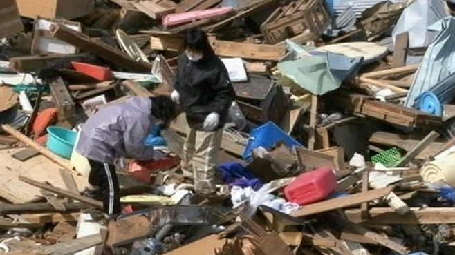 VIDEO: A community in Japan returns to their destroyed homes following tsunami.