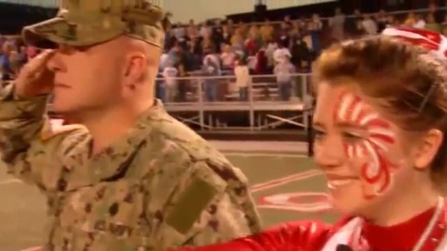VIDEO: Petty Officer Dale Williams hid behind the Color Guard before surprising his daughter, Kendall.