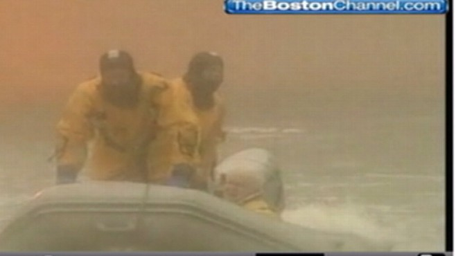 VIDEO: Firemen in Scituate, Mass. rescue family whose flooded home burst into flames.