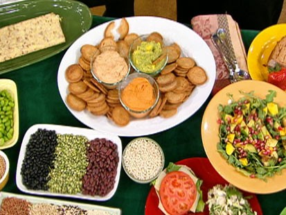 Diane Henderiks creamy sundried tomato spread, roasted red pepper hummus, and mango guacamole are shown.