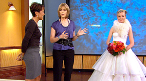 "PHOTO Rosa Claras ivory, silk-satin, organza, strapless ball gown with corset bodice and tiered ball gown skirt is shown, right, in this television screen grab from ""Good Morning America,"" Oct. 8, 2010."
