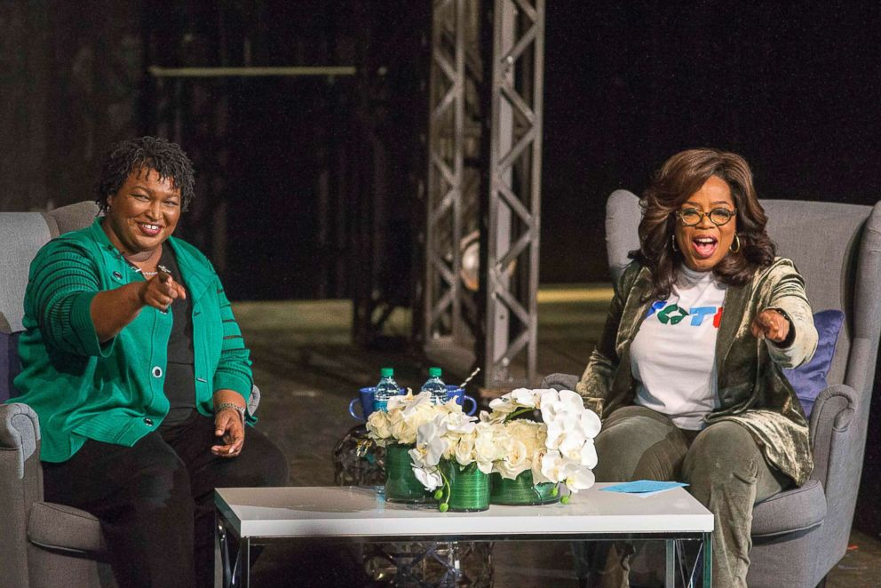 PHOTO: Oprah Winfrey and Georgia gubernatorial candidate Stacey Abrams greet a crowd gathered for a town hall conversation at the Cobb Civic Centers Jennie T. Anderson Theatre in Marietta, Ga., Nov. 1, 2018.