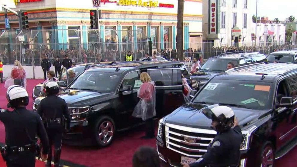 Limousines unload their passengers near the Dolby Theatre in Hollywood, Calif., at the 89th Annual Academy Awards on Feb. 26, 2017.