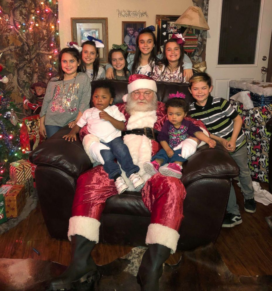 PHOTO: Eight of the 13 Hawthorn siblings pose in an undated photo with Santa Claus.