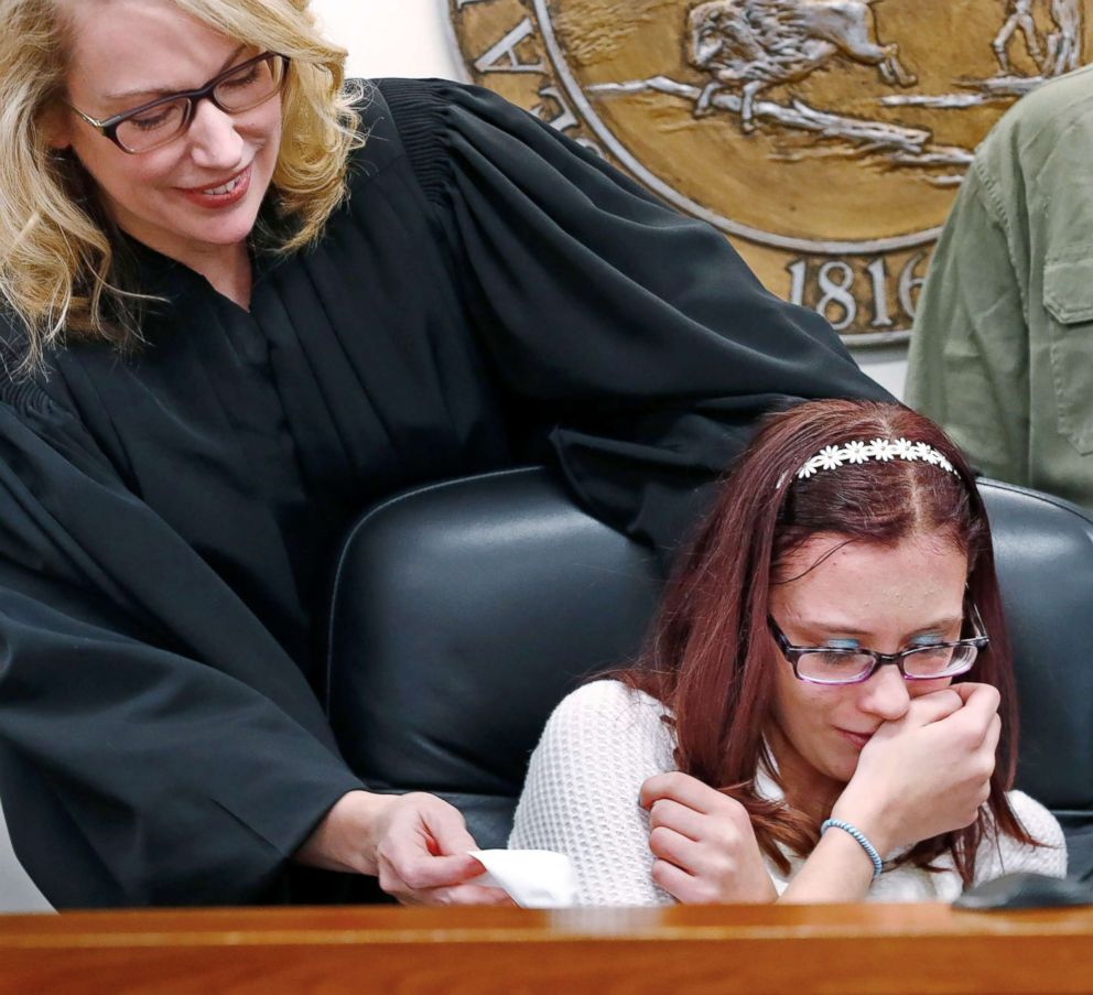 PHOTO: Scarlet is overcome with joy as she poses at the judges bench with Judge Dana Kenworthy at the Grant County Courthouse in Marion, Ind., Nov. 16, 2018.