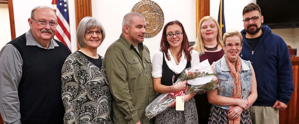 PHOTO: Scarlet poses with her family on her adoption day at the Grant County Courthouse in Marion, Ind., Nov. 16, 2018.