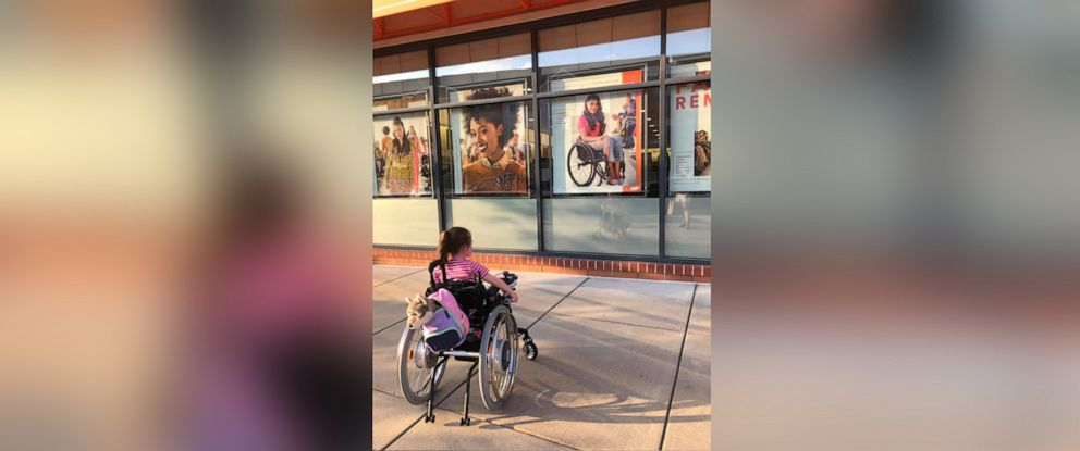 PHOTO: Mother shares photo of her daughter Maren Anderson in a wheelchair mesmerized by Ulta beauty ad featuring model in a wheelchair too.